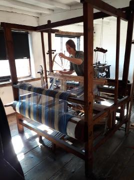 Francesca working on the loom